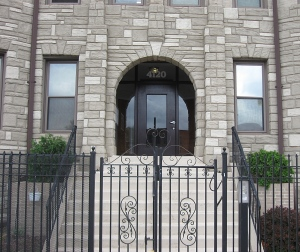 Wrought iron fence compliments the grand entryway